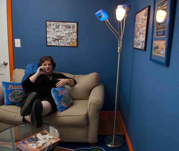 """Photo by Judy Watson Tracy// While Mayanne was away on a trip, sister Cathy swooped in to gather up Gator memorabilia and transform a bedroom into Mayanne's special Double Gator home office. """"Voila!"""" Cathy said, as she opened the door to Mayanne's delight."""