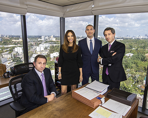 """Photo by Mark Wallheiser//Michelle Suskauer with her partners at Dimond Kaplan & Rothstein. She is the sixth female president of The Florida Bar. """"I hope this opens the door for many more women to come after me,"""" she said. """"This is the 70th year of the Bar, and we've only had six women leading this organization. We have a lot of catching up to do. I am excited, and hopefully my year will inspire others to seek leadership opportunities. I know I've been inspired by the women who have come before me, and I appreciate everything that they've done."""""""