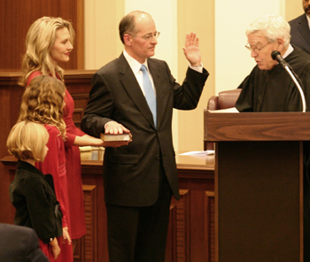 "Charles T. Canady was sworn in as Florida's 82nd Supreme Court justice by former Chief Justice Charles Wells on December 3, 2008, flanked by his wife Jennifer and daughters Anna and Julia. ""As I serve on this court, I will always strive to be a justice for all the people of this great state,"" Canady said."